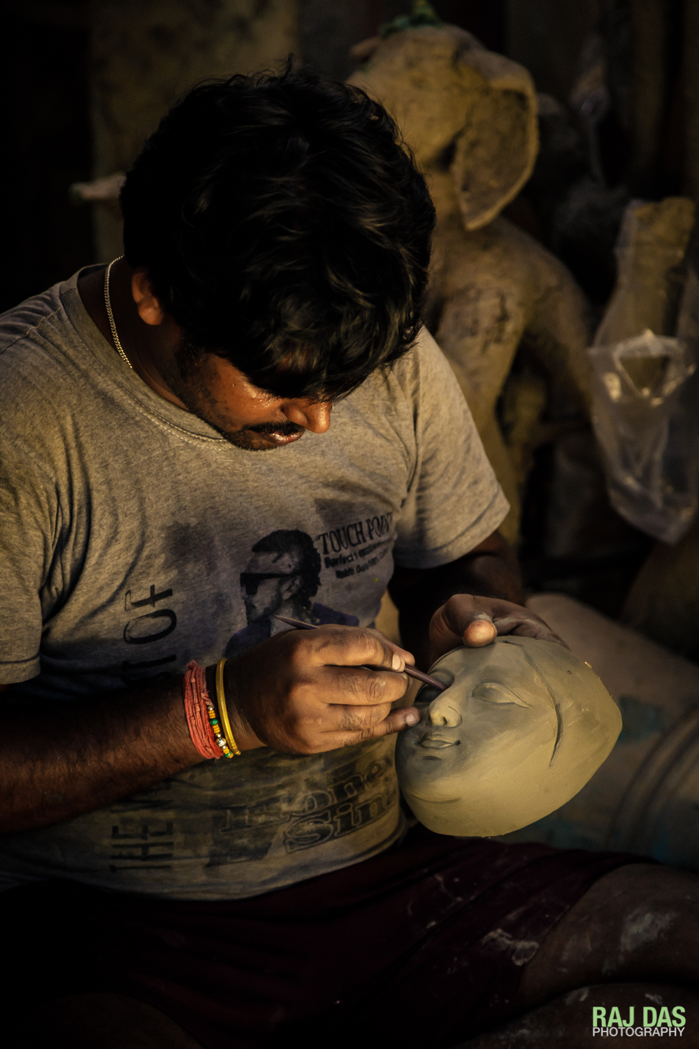 Making the idol's face and painting the eyes requires an artisan with special skill