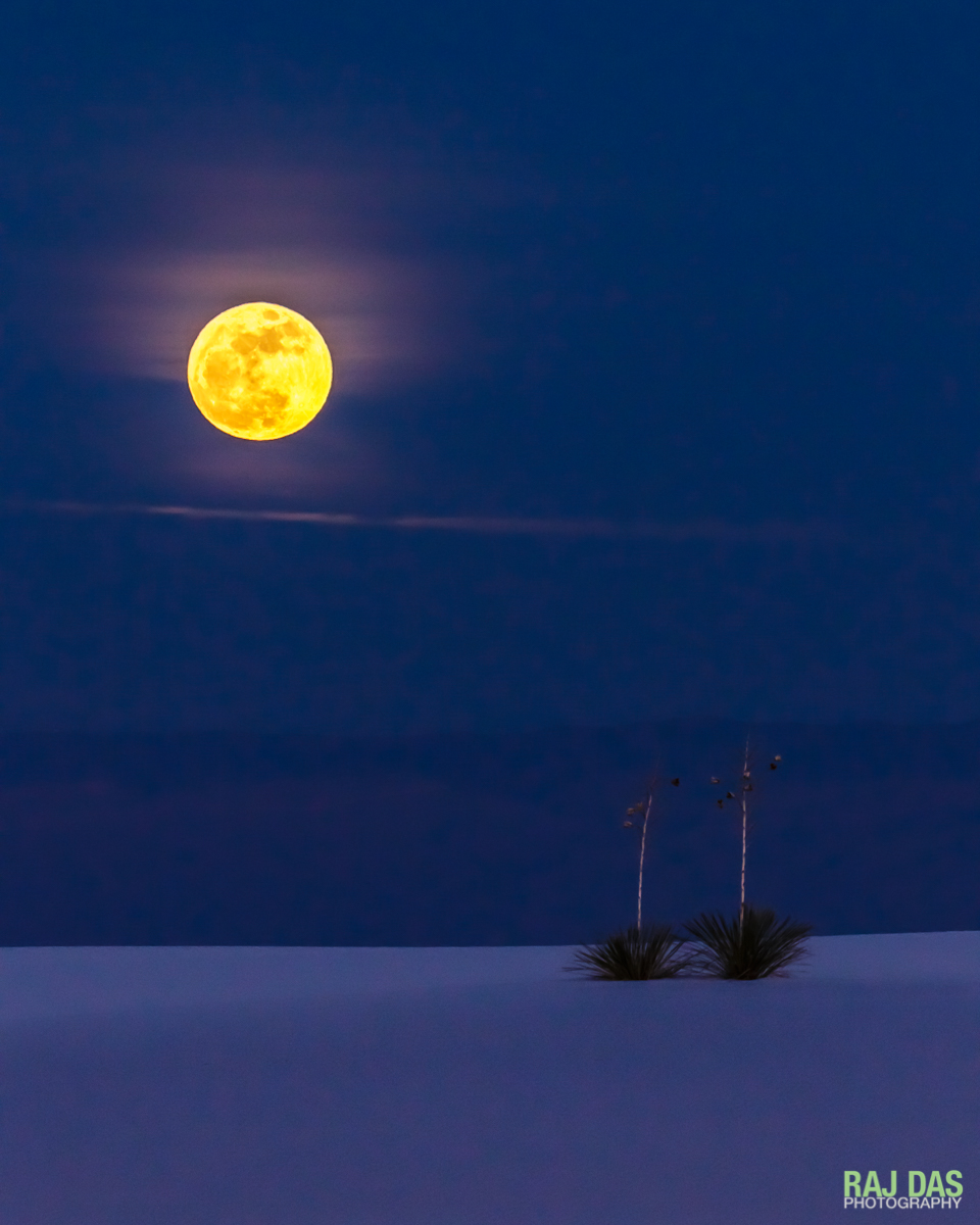 A full moon over the Sacramento Mountains and the White Sands National Monument, NM.