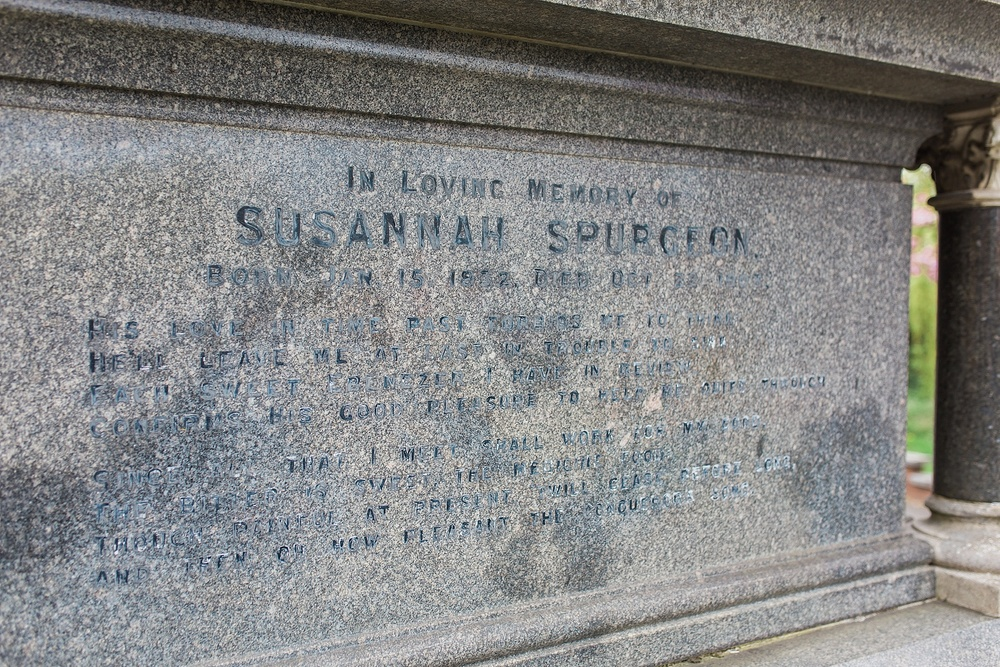 """Susannah's stone reads (Spurgeon's wife): """"His love in time past forbids me to think He'll leave me at last in trouble to sink Each sweet Ebenezer I have in review Confirms his good pleasure to help me quite through Since all that I meet shall work for my good The bitter is sweet, the medicine food Though painful at present twill cease before long And then oh how pleasant the conquerors song"""""""
