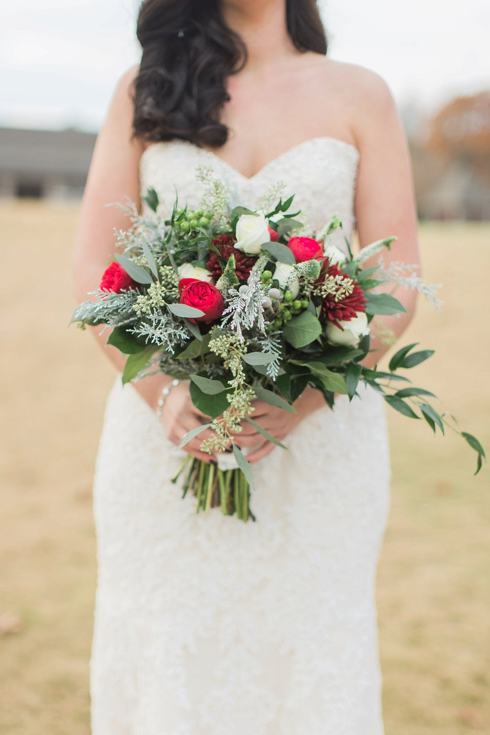 Red, white, and green wedding bouquet
