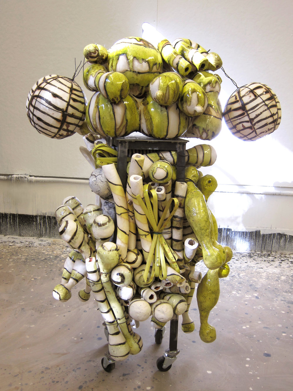 """ROOL"", 2011. Fired ceramic, steel baling wire, steel base, 2"" casters. Photo courtesy of the artist."