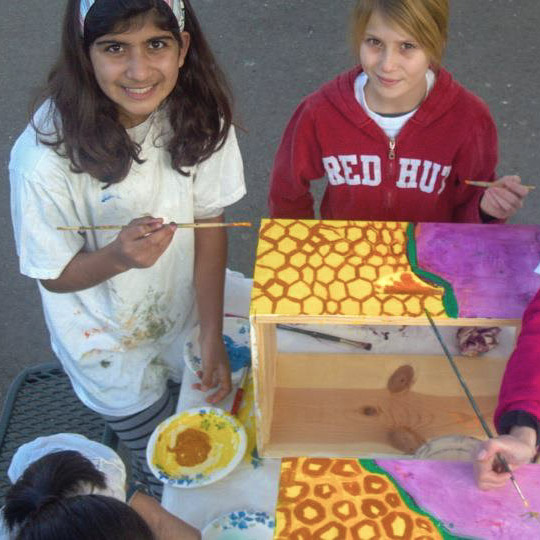 Planet Bee students paint hive.jpg