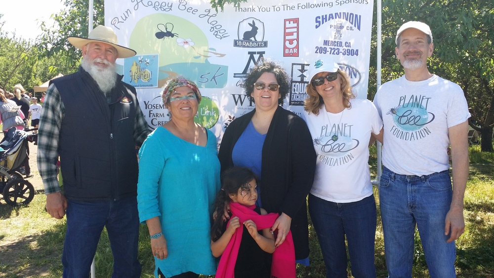 Deb and Bill, right, with the Family of Burroughs Family Farms! Benina Montes is pictured center - her hard work and dedication helped make this event possible. Thank you!