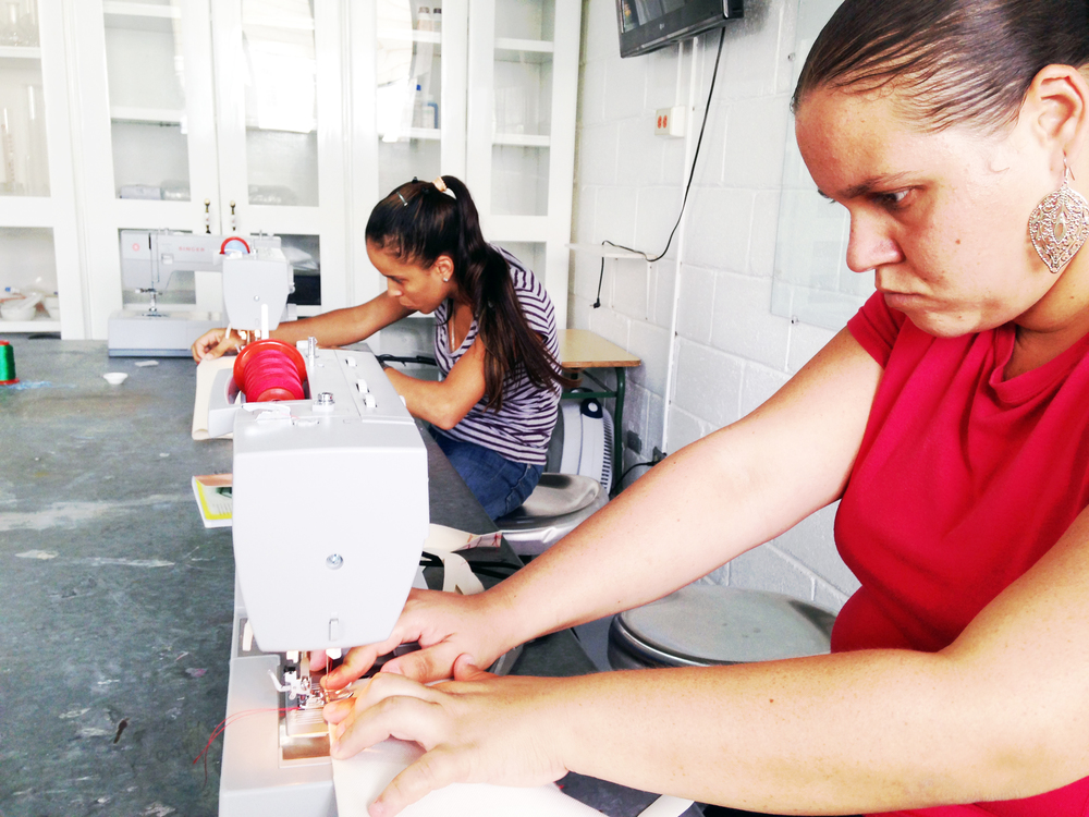 Two of our employees learning how to sew. Santiago, Dominican Republic.