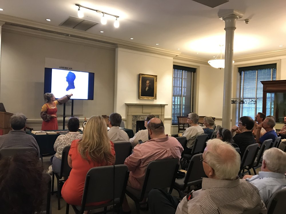 "Lauren Muney is shown here presenting at the  American Philosophical Society  in Philadelphia, PA, in coordination with their exhibit ""Curious Revolutionaries"" (2017)"
