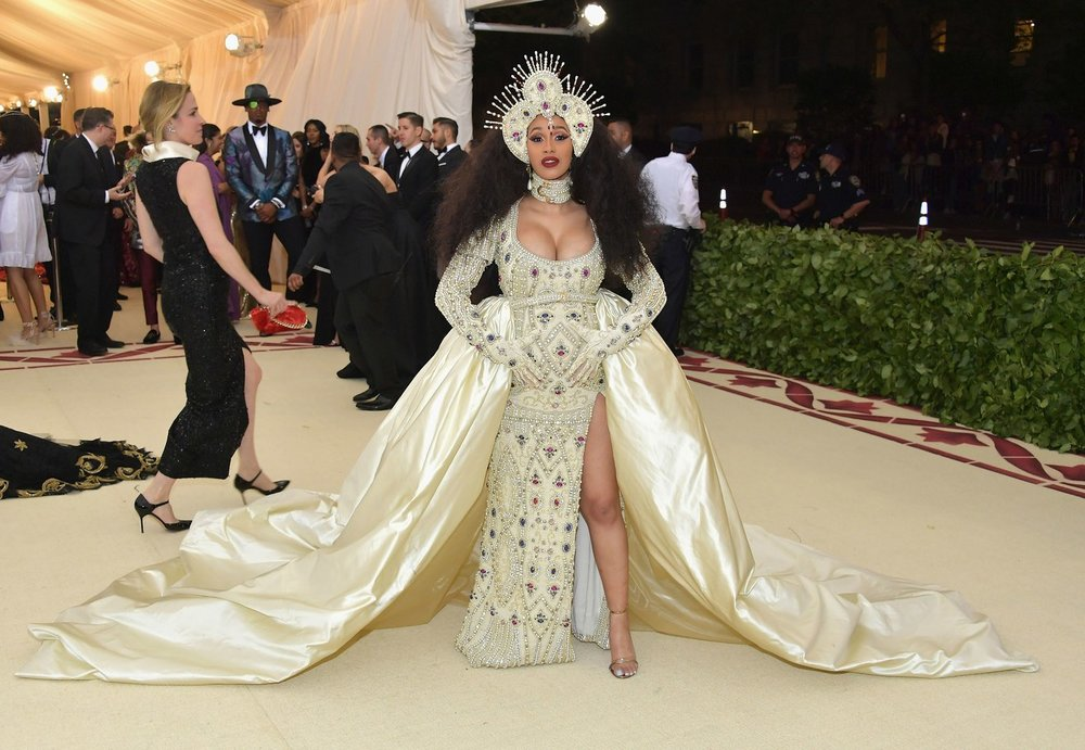 Cardi B wearing custom-made gown and headpiece by  Jeremy Scott