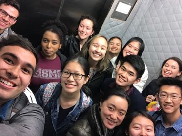 Kai team and Wes alums cramming into an elevator