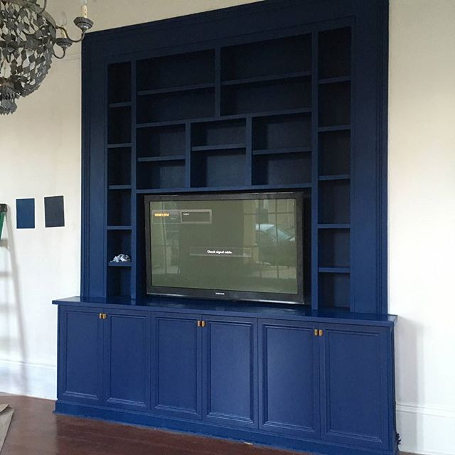 A recent project. Media cabinet/bookcase built into an existing pocket door. Birch and poplar in Downpour Blue  by @benjaminmoore Thanks @riversidelumber and @helmpaint!!! #frenchquarterinteriors #sawdustnola #bookcases #builtins #mediacabinets #carpentry