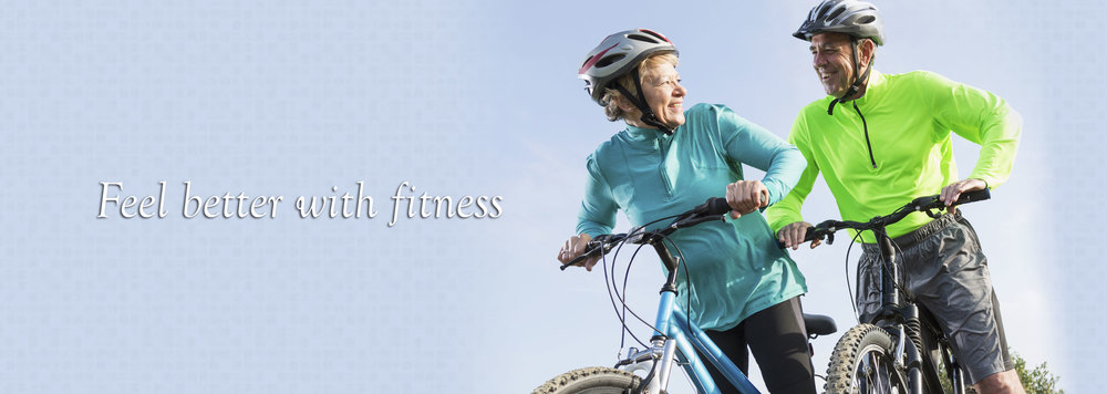 Older man and woman on bikes. Feel better with fitness.