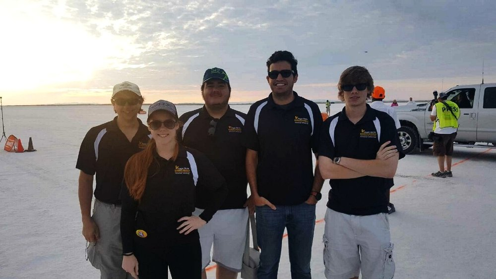 Eagle Works Interns at Bonneville Salt Flats From Left to Right: Johnathan Crossley, Team Member; Julia Mihaylov, Lead Cooling Engineer and Secretary; Sean Rager, Director of Research and Development; Reece Ticotin, President; Alexander Benz, Lead Steering Engineer.