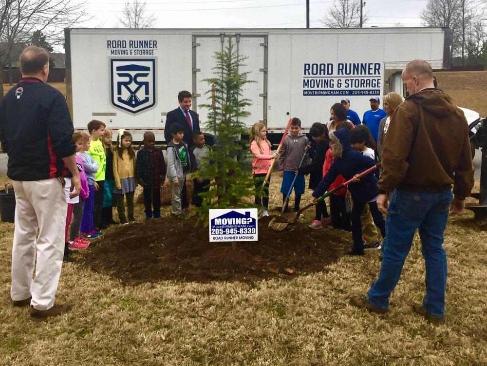 Deer Valley Elementary School second grade students planting Christmas Trees with AUFA volunteers, Hoover City Forester Colin Connor, and Road Runner Moving on January 19, 2018.