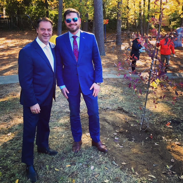 Homewood, Alabama Mayor Scott McBrayer (left) and Road Runner Moving CEO Chase Carlisle (right) at Hall Kent Elementary School on November 27, 2018.