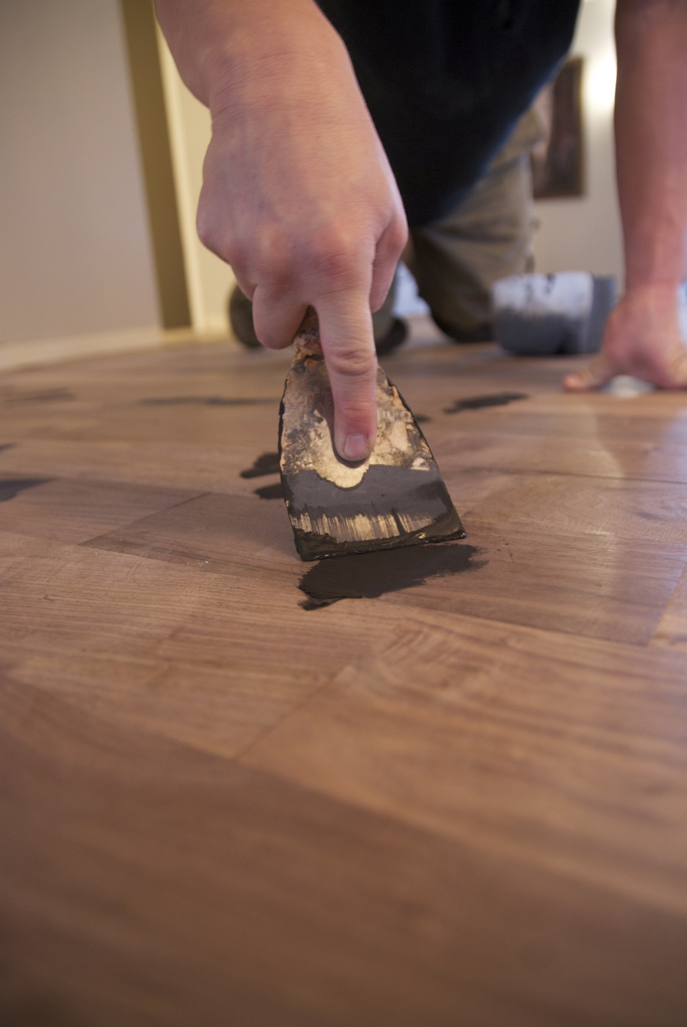 Steve Clifton of ASA Flooring staining hardwood floors in Denver