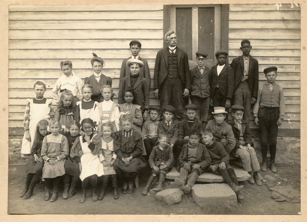 This is a picture of my great grandfather's school in Lomontville, NY. He is the gentleman in the back with the mustachios. My grandmother is in the front row; 5th from the left.