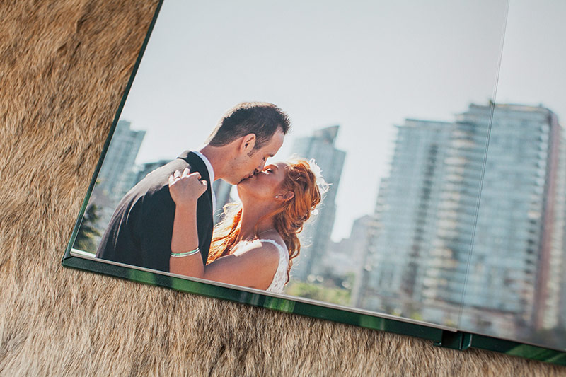 bride and groom kissing in wedding album