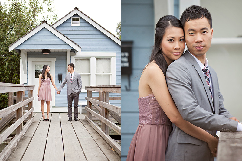 engagement photo of couple in front of cute house