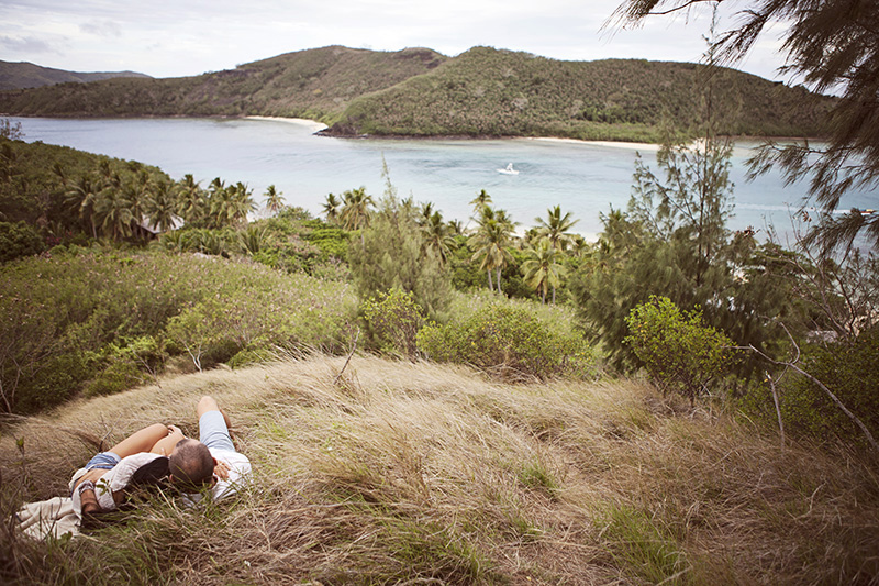 Couple laying in the grass on a mountain