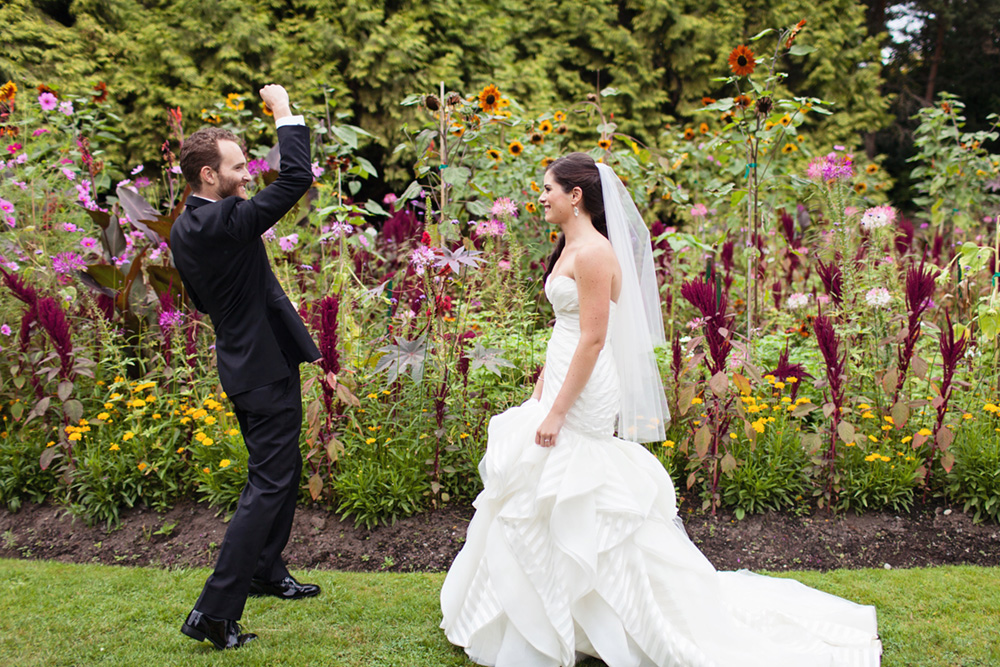 Groom fist-pumps for his beautiful bride