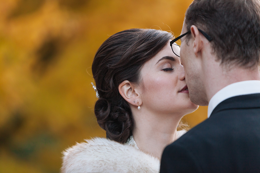 Bride and groom share an intimate kiss
