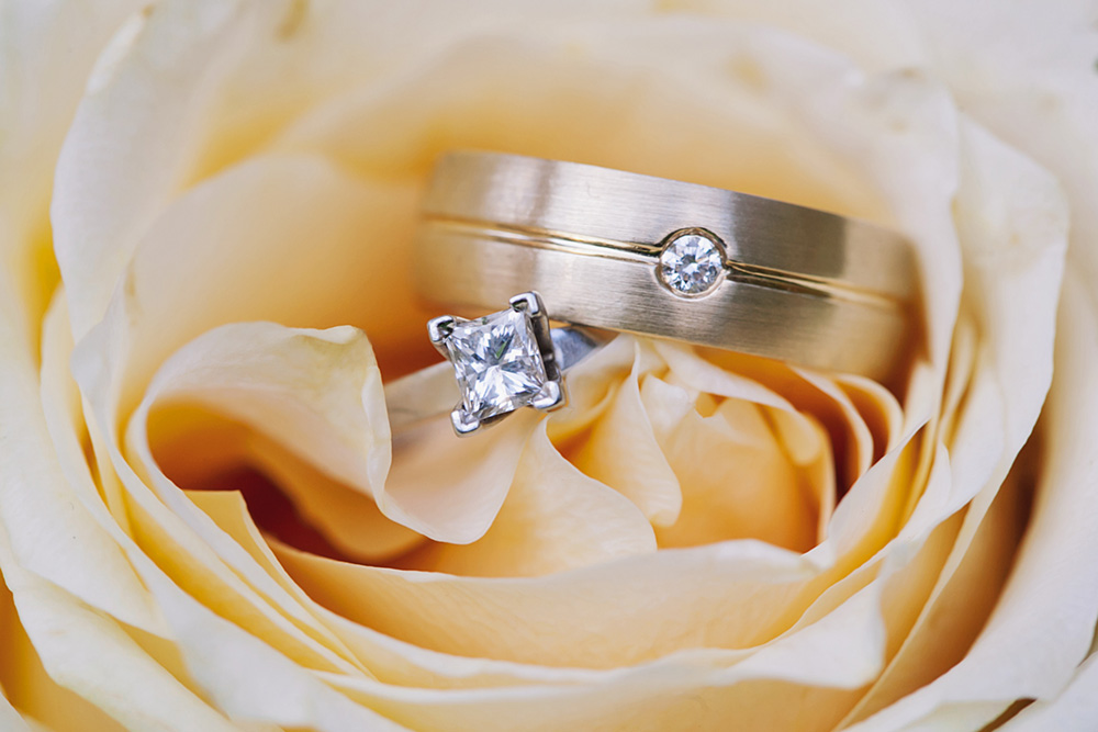 Vancouver Wedding Photo: Wedding rings inside a  yellow rose