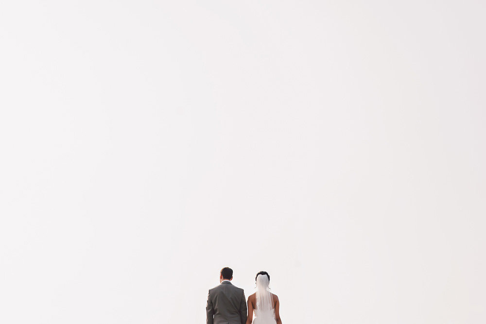 Bride and groom with a vast sky