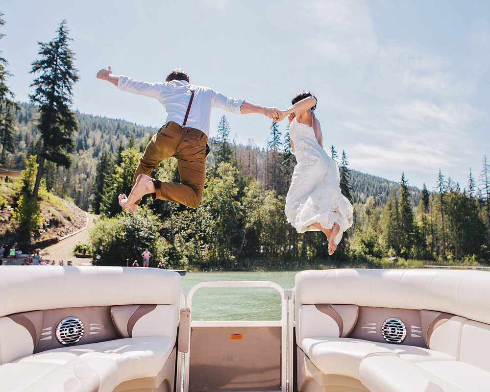 Couple jumps off a boat in their wedding clothes