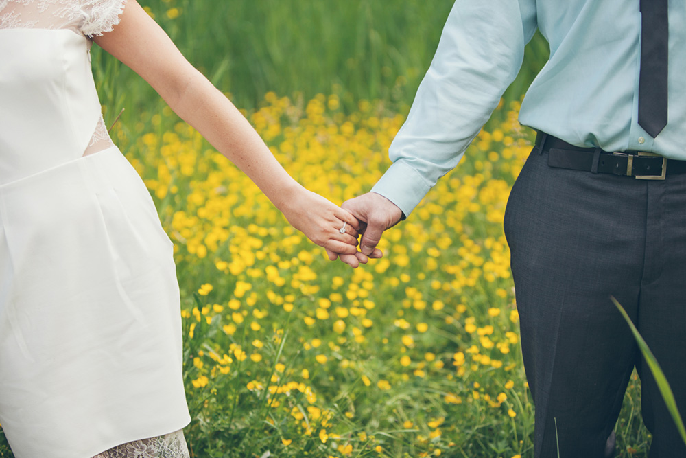 Vancouver portrait photography: engaged couple holding hands