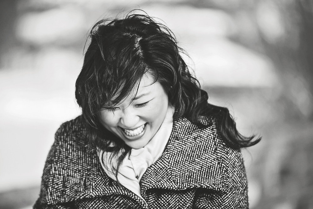 candid photo of girl laughing  by Vancouver photographer