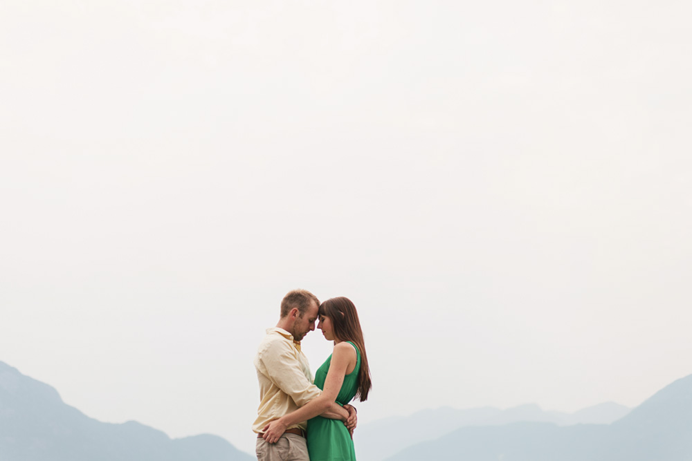 couple with arms around each other in front of mountains