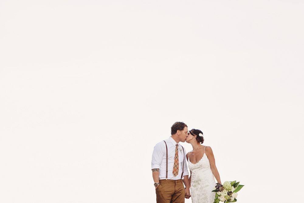 Bride and groom kissing on a summer day