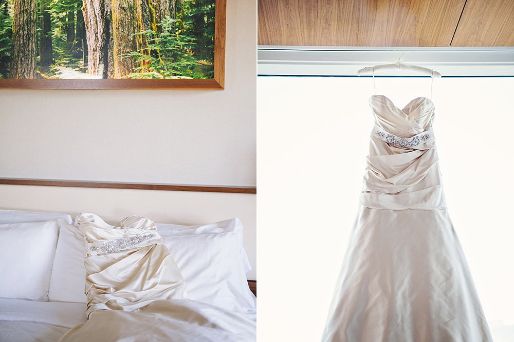 Wedding dress hanging in a hotel room