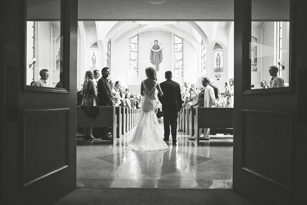 A Dad walks his daughter down the aisle