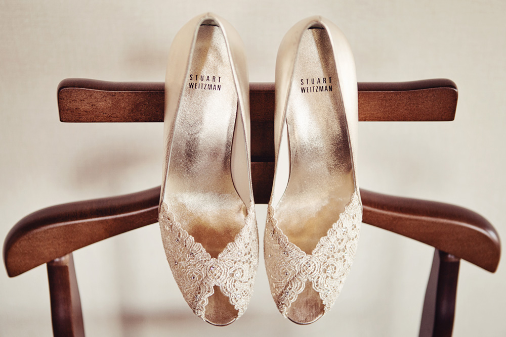 wedding shoes hanging from chair