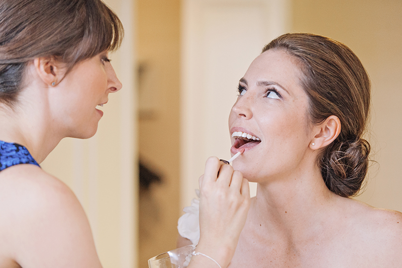 bride having lipstick touched up