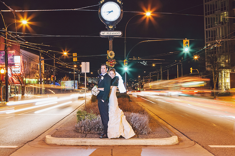 portrait of bride and groom with streaking lights from cars
