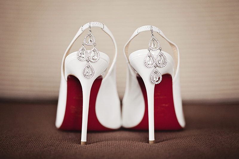 earrings hanging from wedding shoes