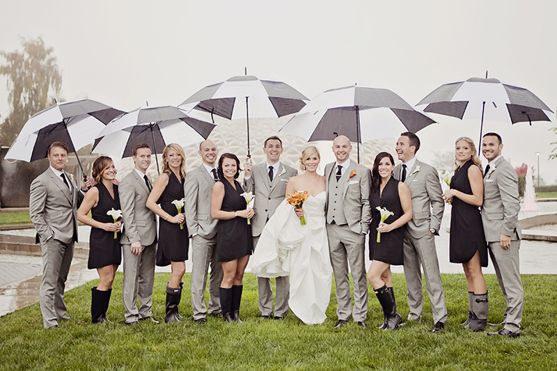 wedding party portrait with umbrellas