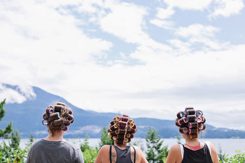 bridesmaids outside with curlers in hair