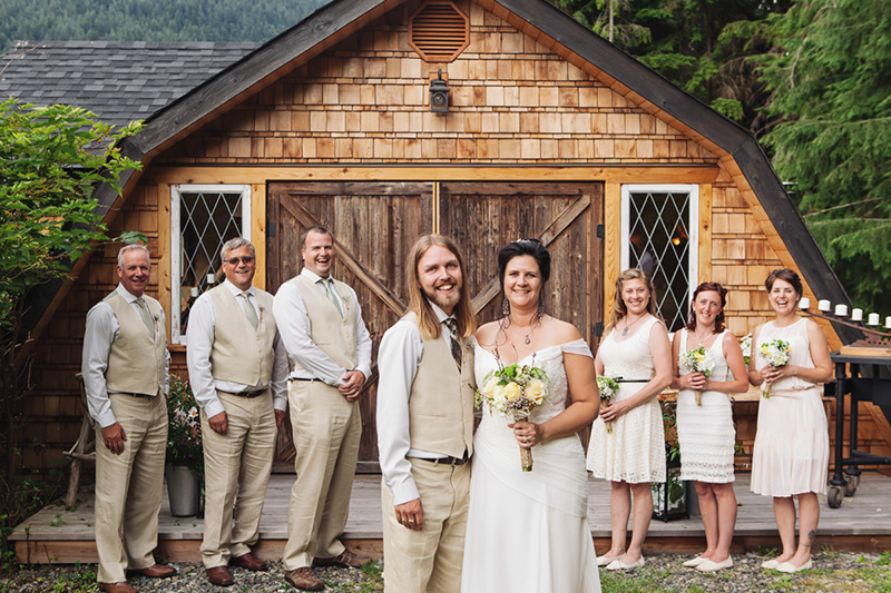 wedding party portrait in front of rustic chapel