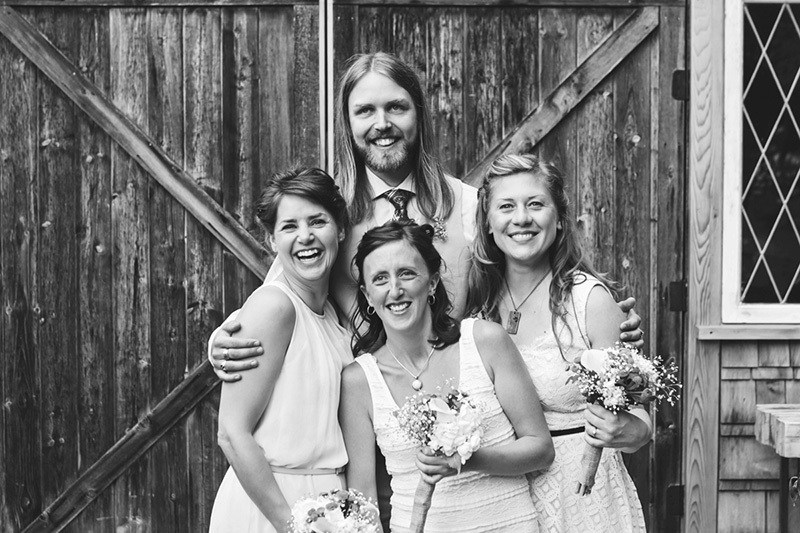 groom with bridal party laughing