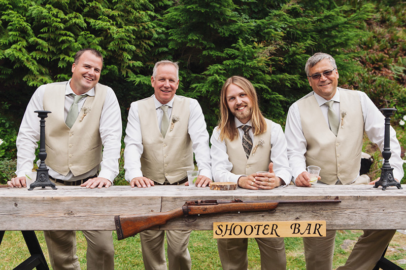 groom and groomsmen in front of shooter bar