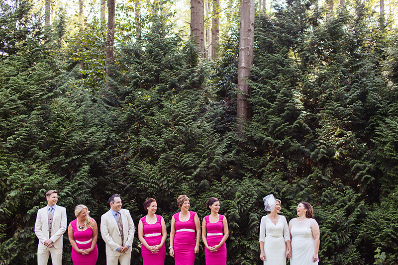 wedding party in front of tall trees
