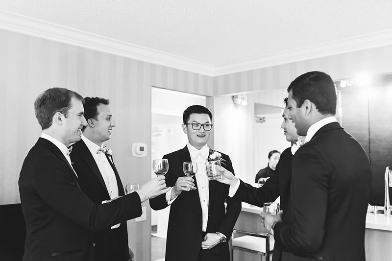 groom and groomsmen toasting