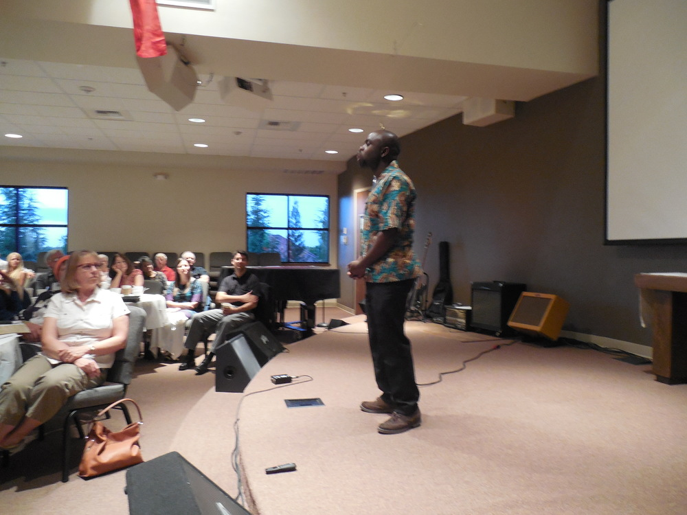 Mulenga sharing the testimony of God's faithfulness in his life with East Parkway Church in Sacramento, California in March 2015.