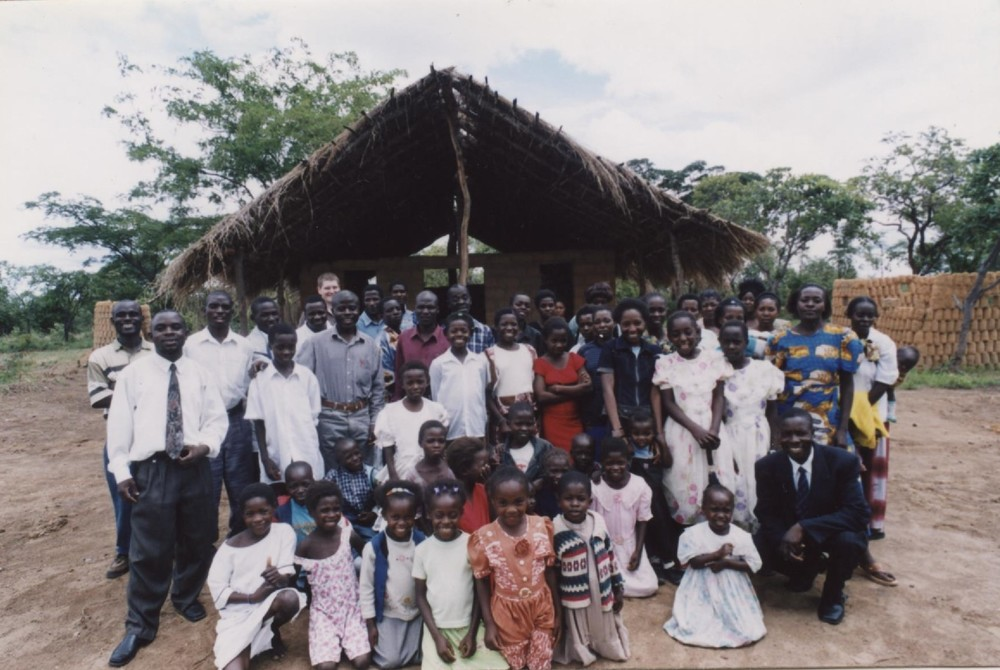 Mulenga and his congregation in front of their church located far out into the bush of rural Zambia.  Mulenga pastored this church in 2003.