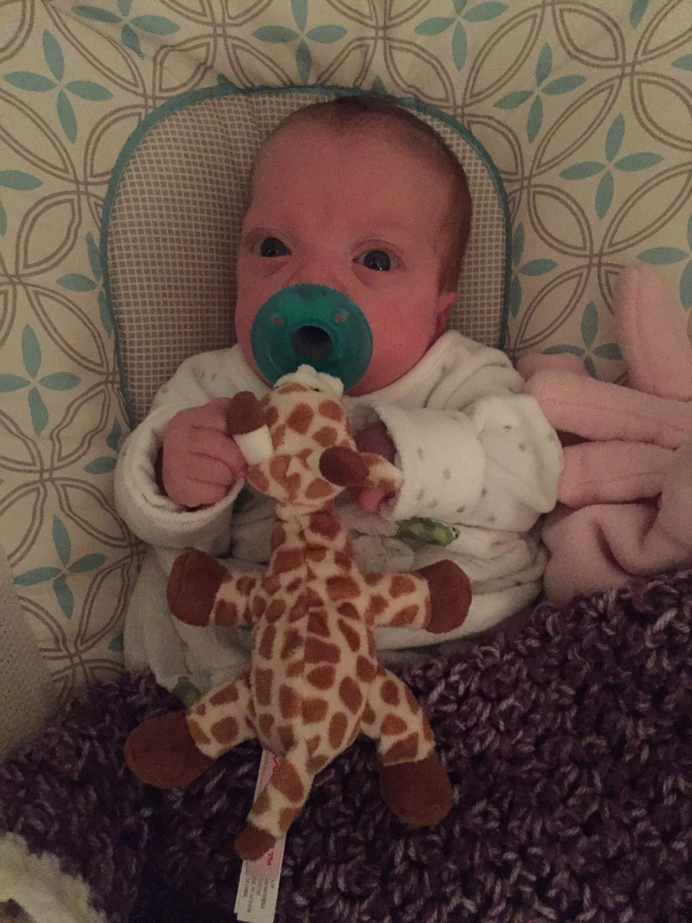 Snuggle time with her giraffe