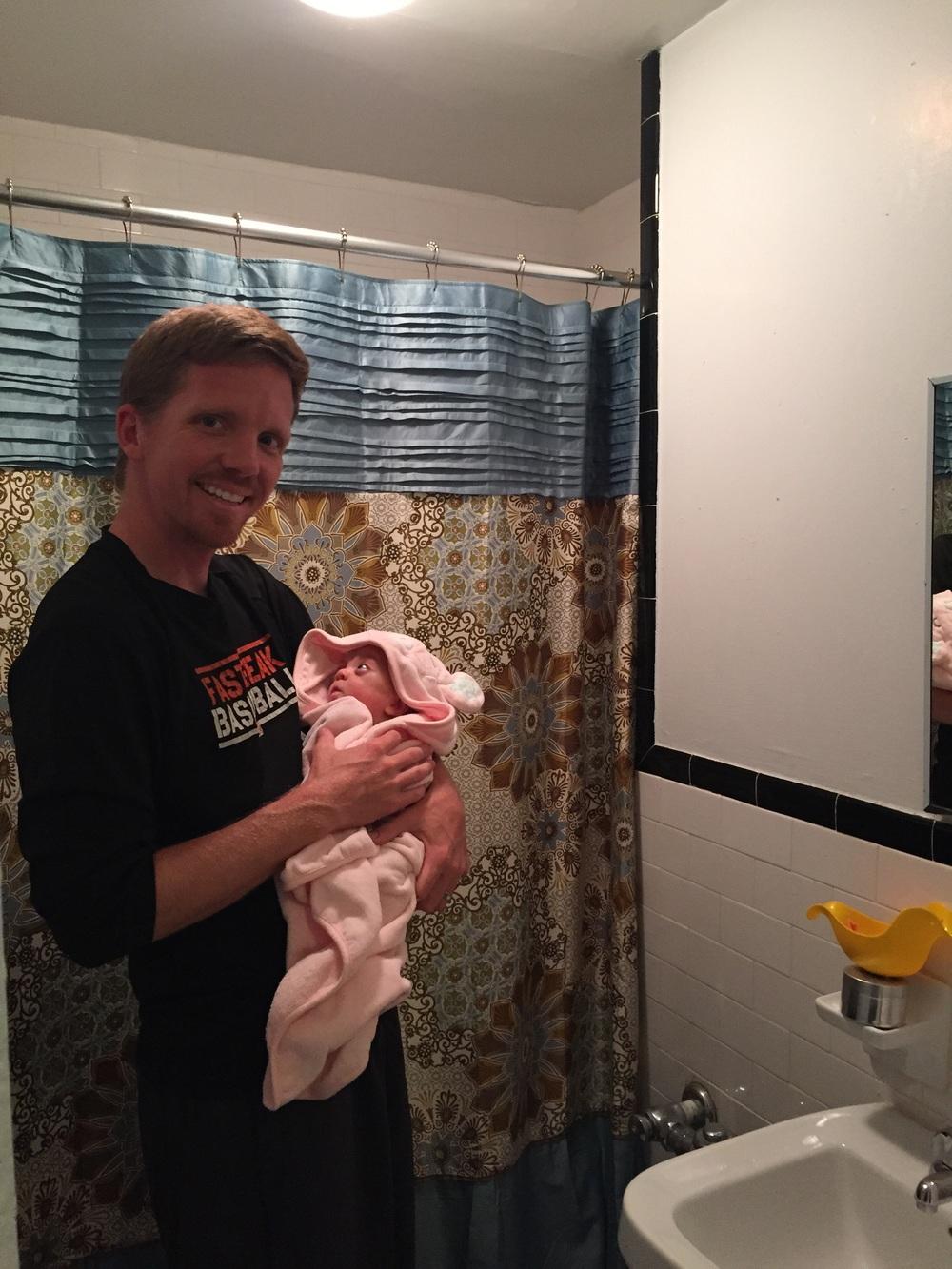 Bathtime fun! She's mesmerized by her Daddy!