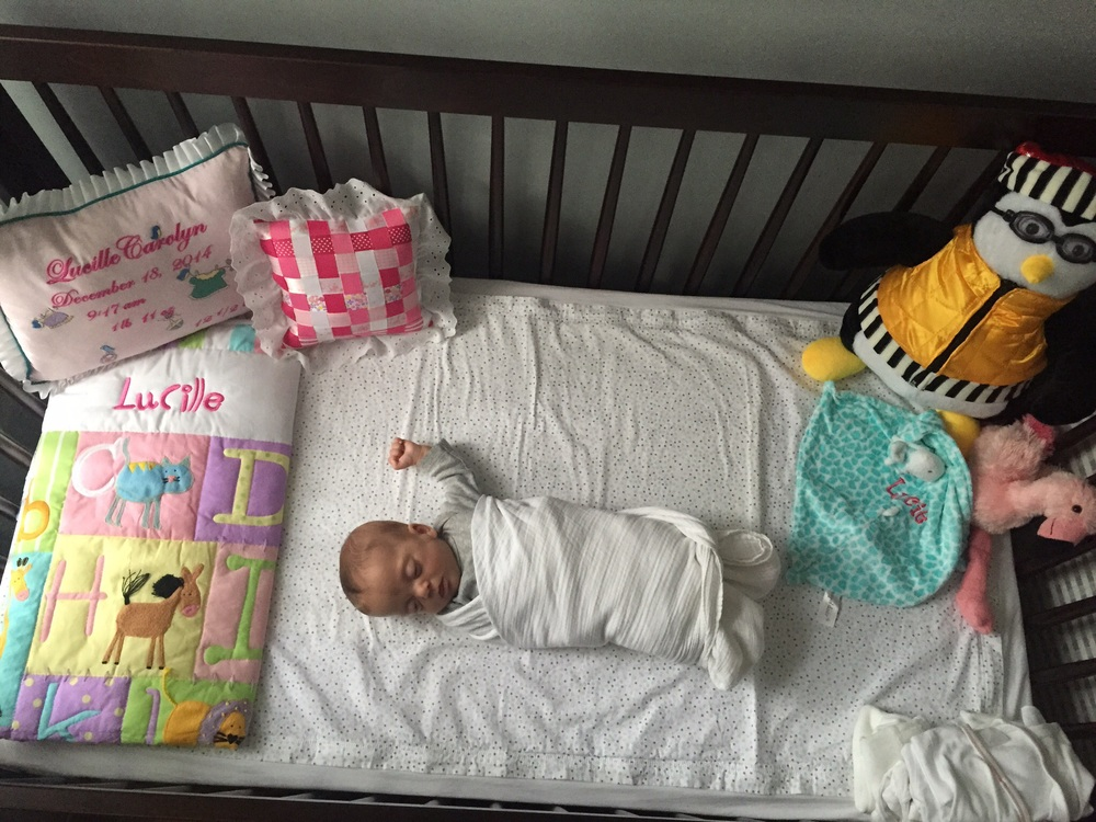 She's been sleeping in her crib more and more, even though she still mostly sleeps in her rocker. When we swaddle her, we have to leave her left arm out or else she'll wake up within 10 minutes!