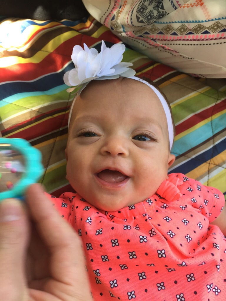 Loves to play with her rattle!