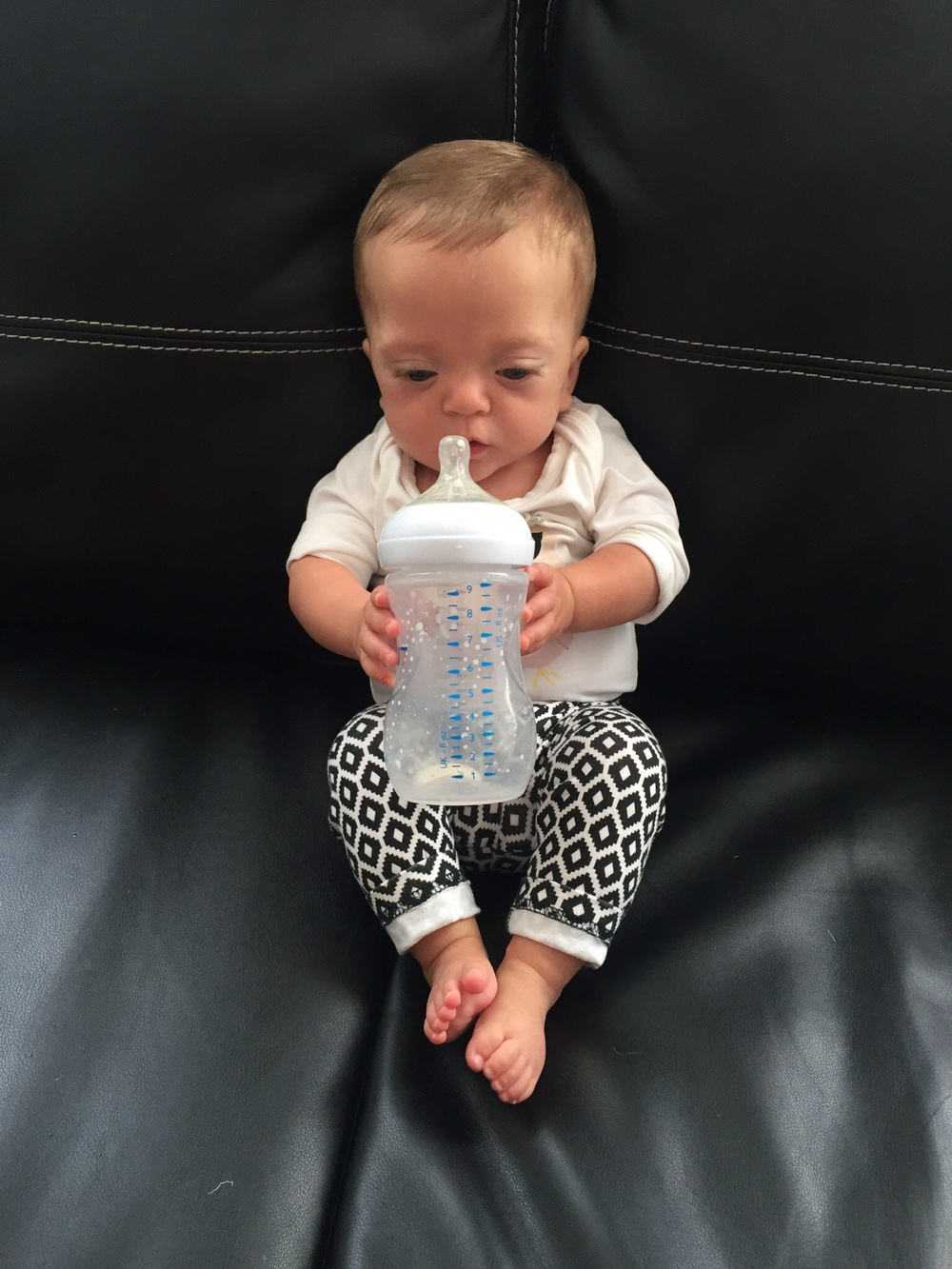 Eating from a big bottle, And starting to learn to hold it… CHECK!